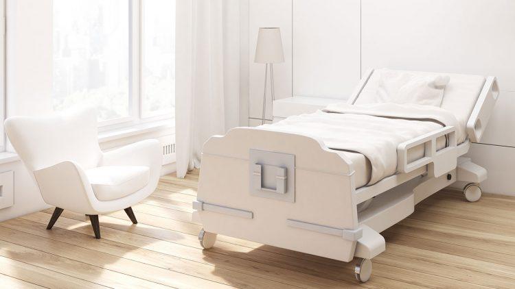 Modernes Pflegebett in einem modern eingerichteten Zimmer